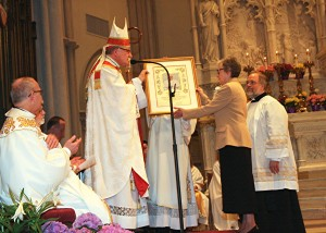 Bishop Zubik presents picture of Pope Francis to Sister Grace Fabich, General Superior.for page 2