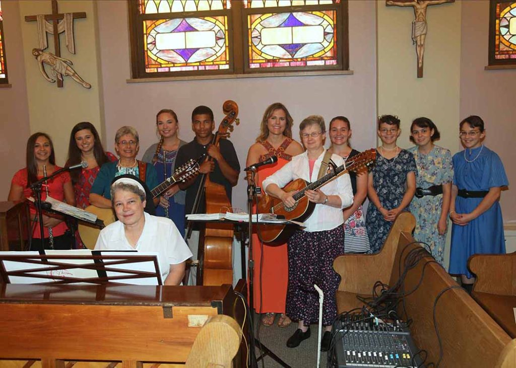 Sr. Janell Banko with the St. Agnes Folk Group and Sister Donna Smith